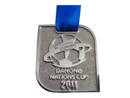 medalla danone cuadrada